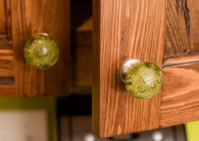 spunky green glass handles to match the bright paint scheme