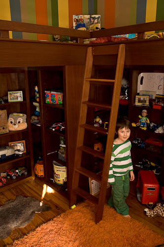 Custom designed and built bunk beds with under bed shelving