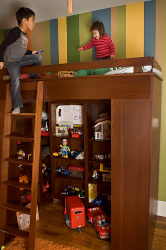 Custom designed bunk beds with railing and ladder