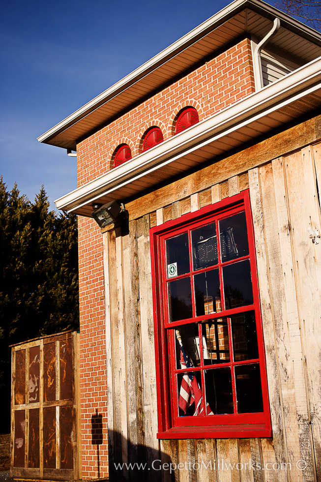 Handmade wooden windows painted red